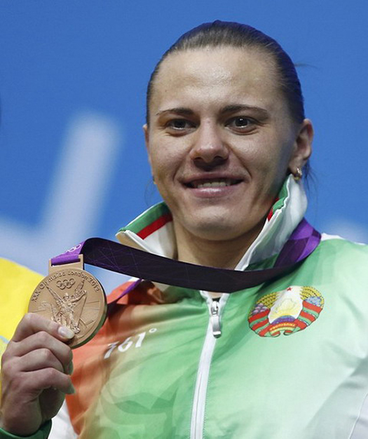 Belarus' Iryna Kulesha pose at the podium with her bronze medal of the women's 75Kg weightlifting competition at the ExCel venue at the London 2012 Olympic Games